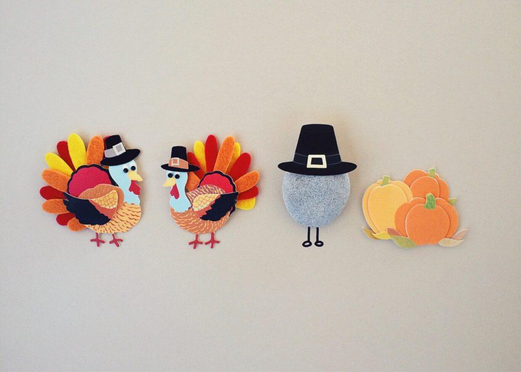 Felt Thanksgiving decorations depicting turkeys, a pumpkin, and a pilgrim