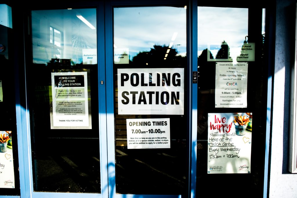 "Picture showing a sign that says ""Polling Station"" on a door"