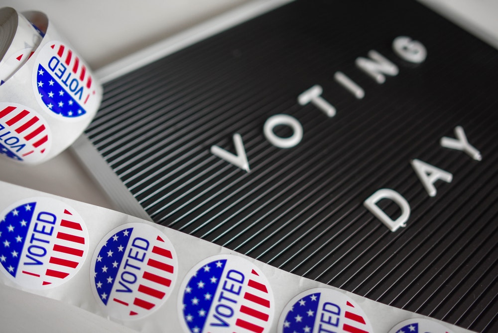 """Sign of """"I Voted"""" next to a board that says """"Voting Day"""""""