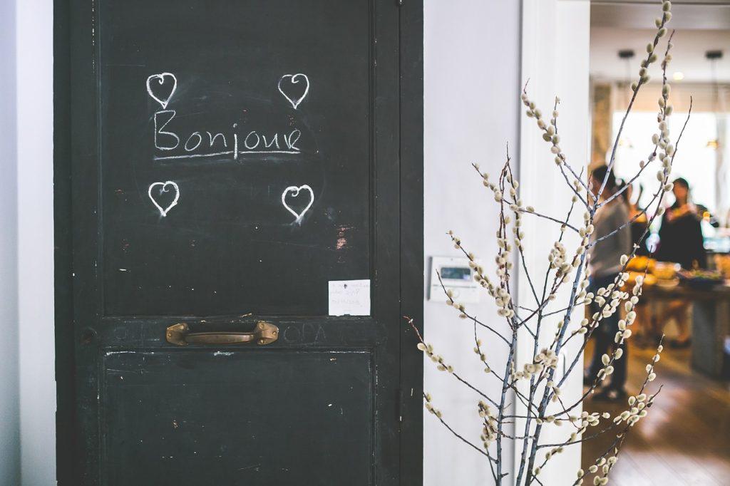 Bonjour written in chalk on a door
