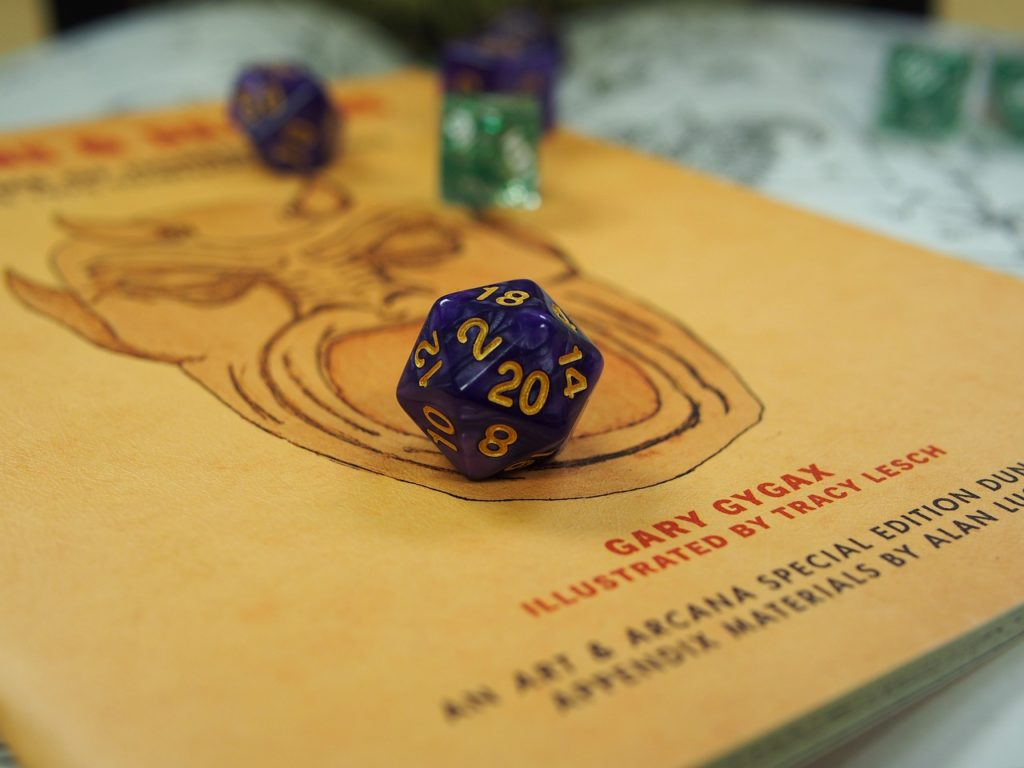 Purple dice on top of yellow book