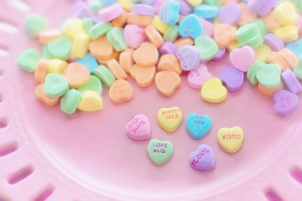 Conversation hearts on a pink background