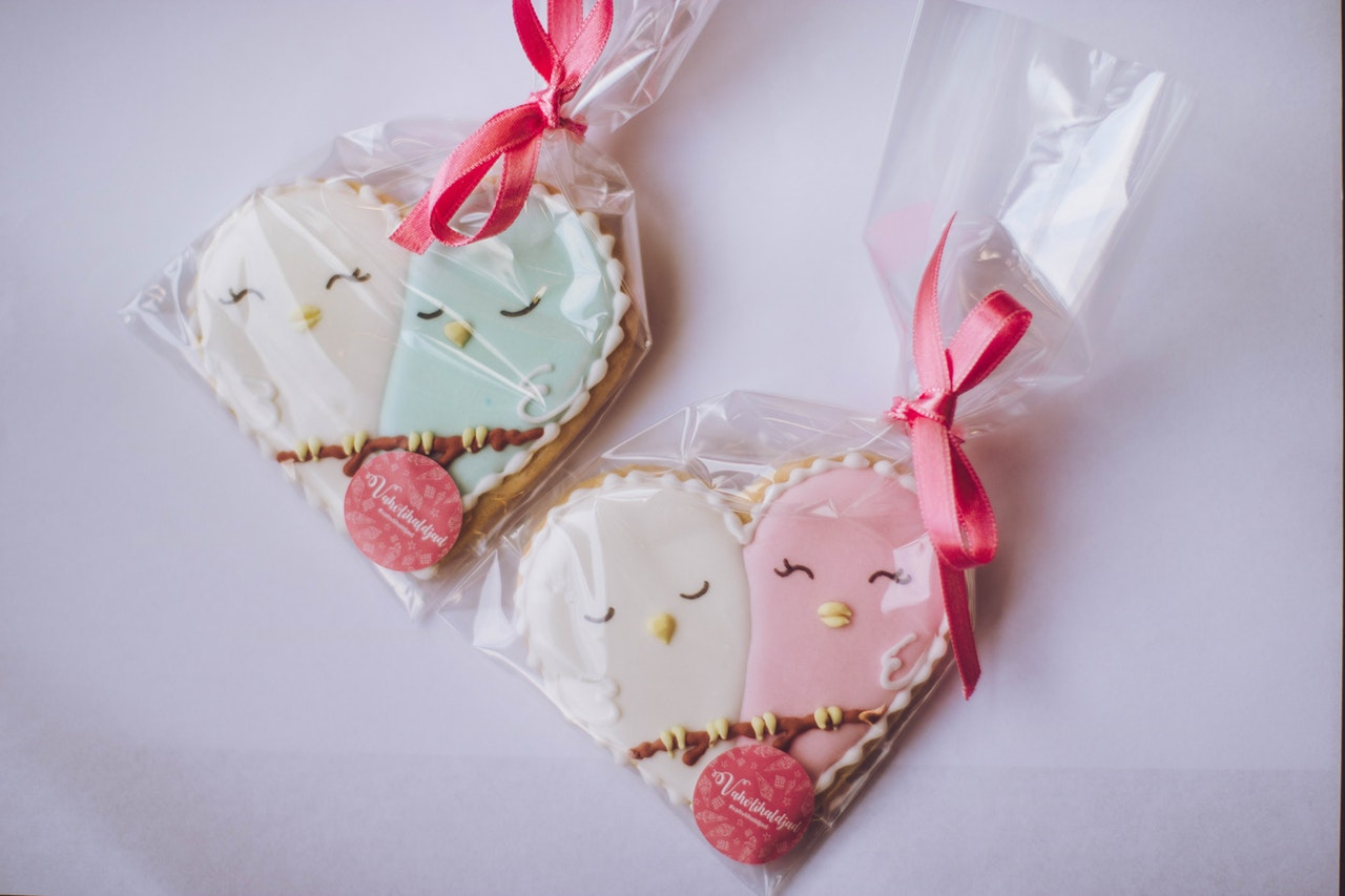 Two heart shaped cookies in separate bags