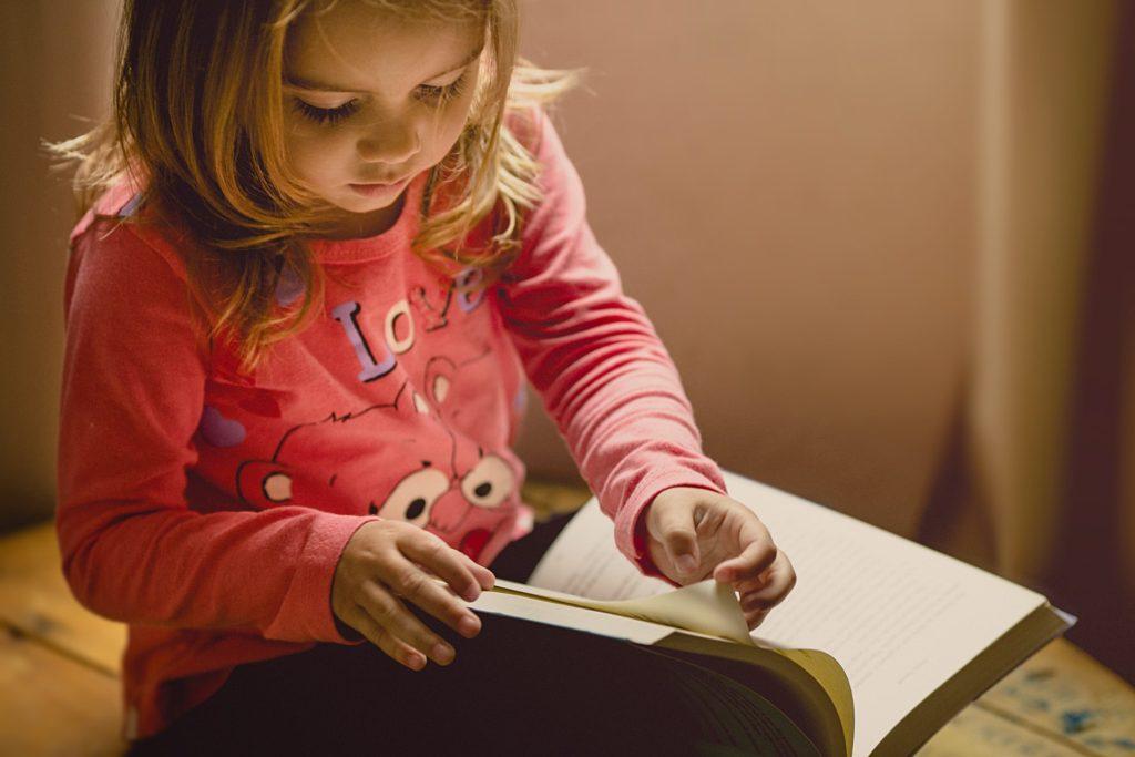 Girl flipping through a book