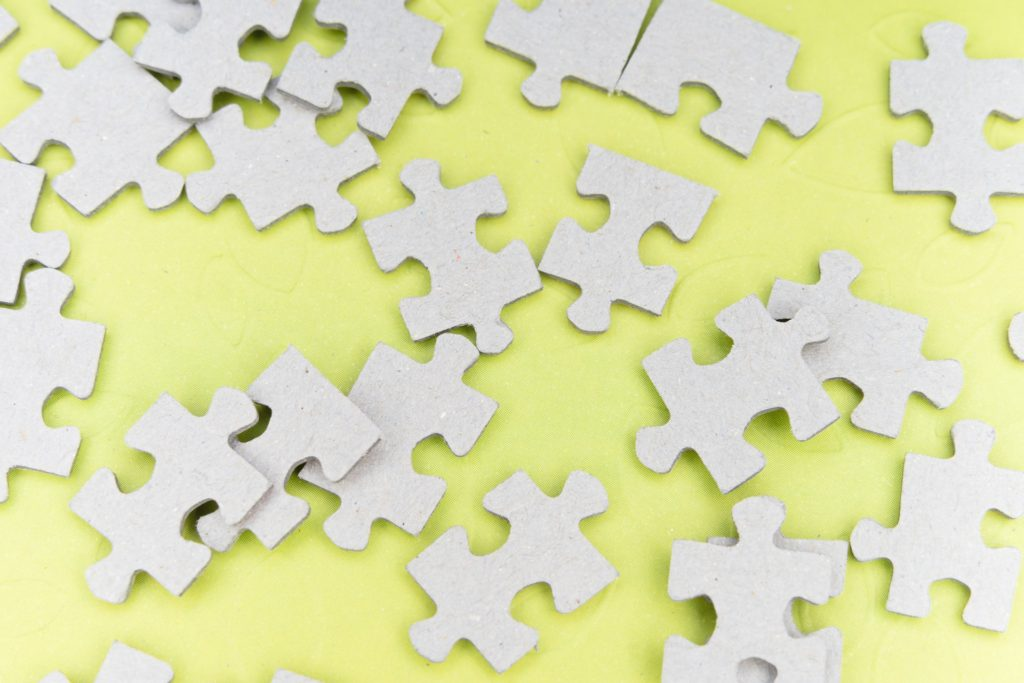 Puzzle pieces on a yellow background