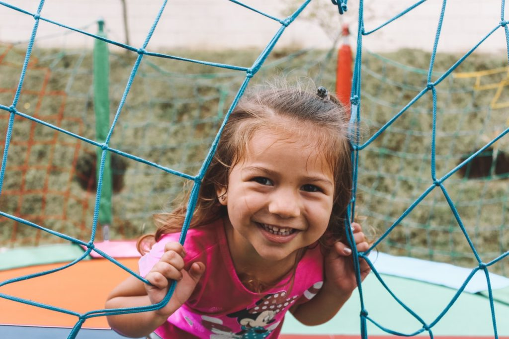 Girl smiling on a playground