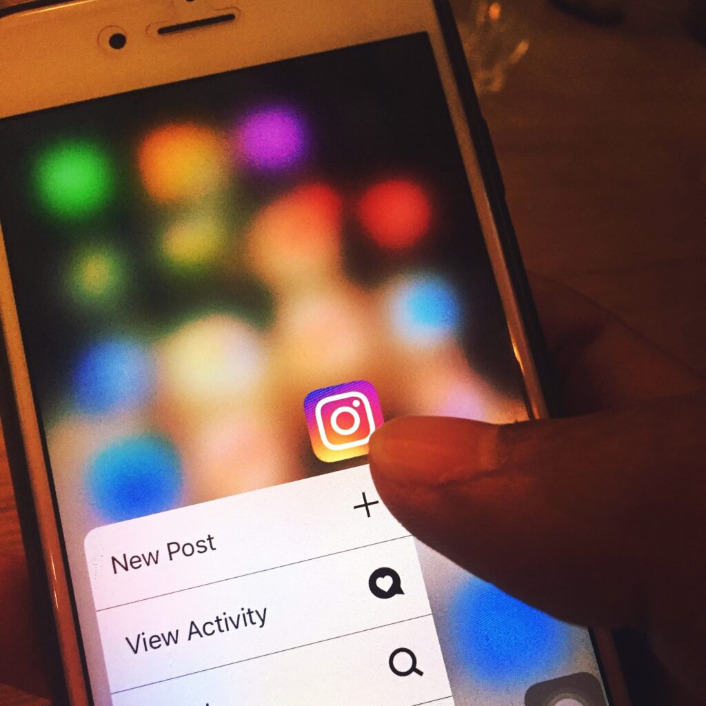 Person opening Instagram on iphone