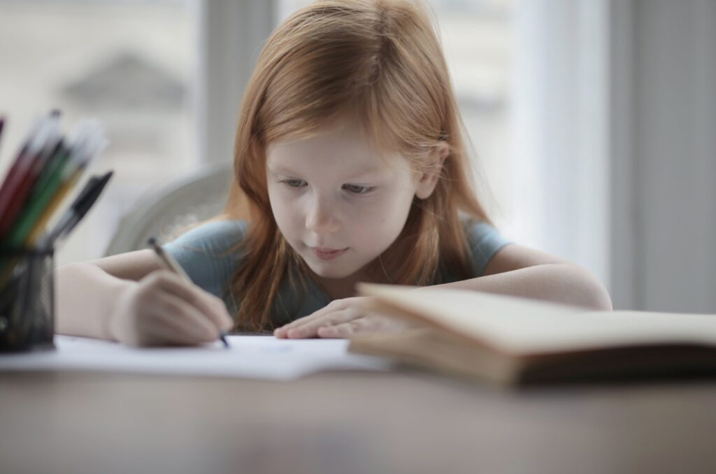 Girl writing at a desk